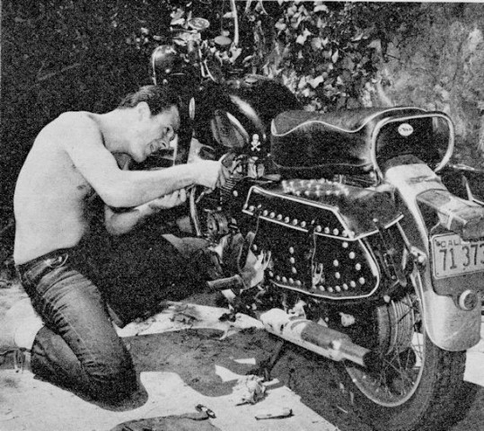 Robert Culp working on his motorcycle, circa 1959